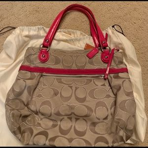 Tan coach bag with bunk leather details